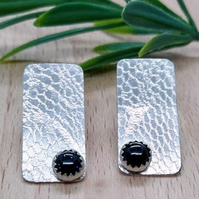 Textured sterling silver stud earrings with moonstones.