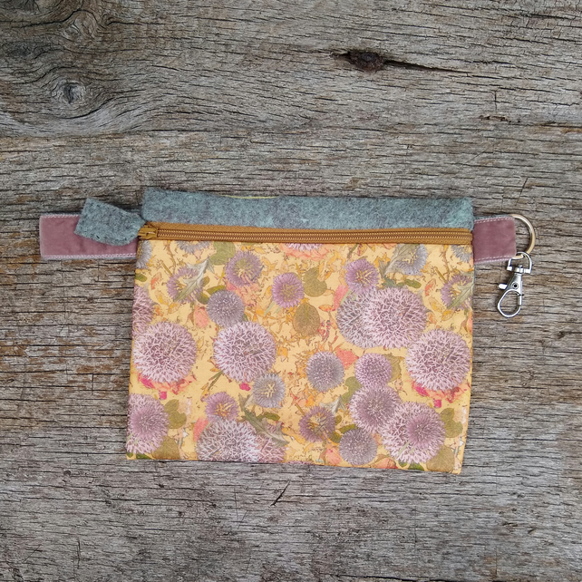 Floral zip pouch with swivel clip