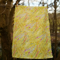 Yellow floral design tea towel with hanging loop