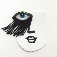 Eye brooch with long lashes