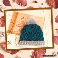 Stylish Beanie hat with faux fur Pom in teal and grey.