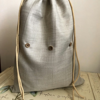 Strong drawstring bag in natural linen look fabric with cord.