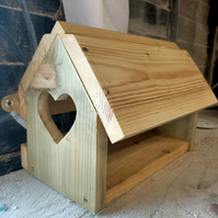 Rustic wooden recycled bird feeder with love hearts
