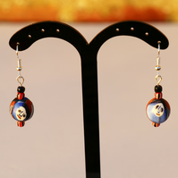 African glass bead earrings with cute faces in blue and red. Silver plated hooks