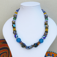 Patterned african necklace in blue and yellow recycled glass beads