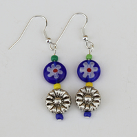 Drop earrings with daisy flowery beads. Blue and antique silver retro flowers.