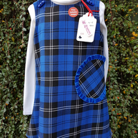 Age: 4-5y. Blue check tartan lined pinafore dress.