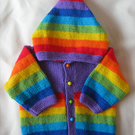 Hand knitted purple rainbow hooded jacket for baby aged 3 to 6 months