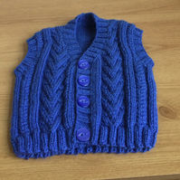 Hand knitted cabled baby waistcoat