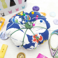 Quirky pumpkin style pin cushion, perfect for any sewing enthusiast