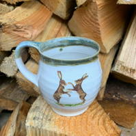 Ceramic pottery cup mug boxing hare stoneware