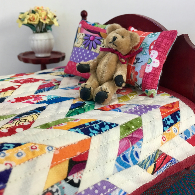 Miniature scrappy patchwork quilt with three cushions