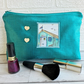 Large turquoise make up bag with beach hut decorative panel