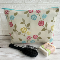 Rambling roses toiletry bag with pink, yellow and blue roses