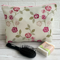 Rambling roses toiletry bag in shades of pink on cream
