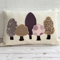 Woodland trees cushion with purple and gold trees