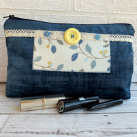 Large blue make up bag with leaf and berry print decorative panel