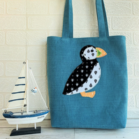 Puffin tote bag in turquoise with black and white patterned puffin