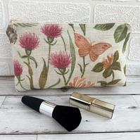 Make up bag, cosmetic bag with orange butterfly amongst honeysuckle and clover