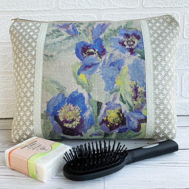 Beige and white toiletry bag with floral panel featuring purple flowers
