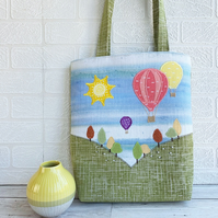 Tote bag with hot air balloons flying over hills