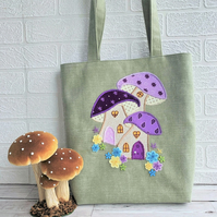 Pale green tote bag with purple toadstool houses