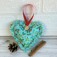 Mint green Christmas hanging heart decoration with holly and mistletoe