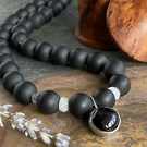 Black Onyx and agate pendant necklace with Aquamarine and handmade silver clasp.