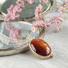 Oval red Tigers Eye and silver pendant with chain