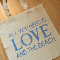 All you need is love and the beach. Tote bag