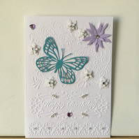 Pretty embossed flower and butterfly Birthday card. CC405