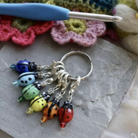 Ladybird crochet stitch markers, rainbow coloured.
