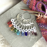 Numbered knitting or crochet stitch markers, rainbow crystal beads.