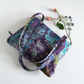 Shoulder bag with a chunky zip, made in a painterly, abstract, designer fabric.