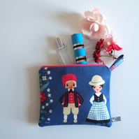 Make up bag or pouch in a vintage Danish tablecloth folk art print