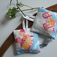 Pair of Lavender bags made from a child's vintage Sunday hanky.
