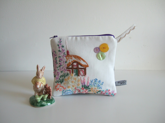 Make up bag or storage pouch with a vintage embroidered thatched cottage.