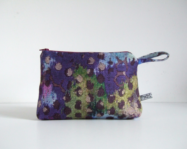Toiletries or make up bag in dramatic abstract print.