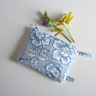 Make up bag or purse in a vintage blue floral embroidery.