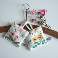 A pair of lavender bags with vintage floral daisy embroidery