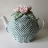 Hand knitted duck egg blue tea pot cosie with peony flower
