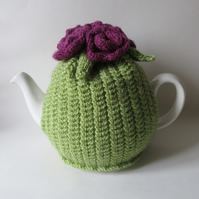 Hand knitted stem stitch tea pot cosie with roses