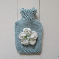 Hand knitted duck egg blue hot water bottle with large peony flower