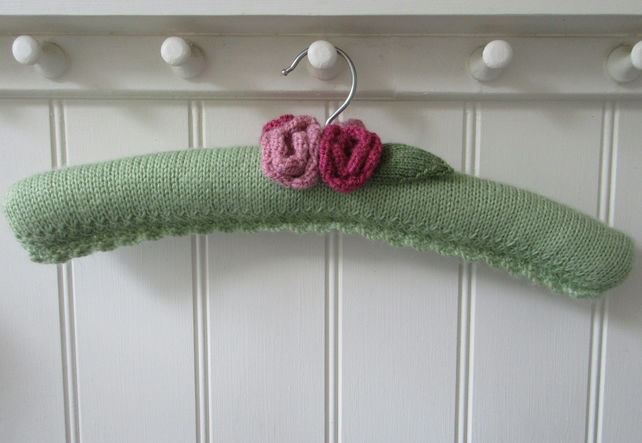 Hand Knitted padded Christmas coat hanger with roses