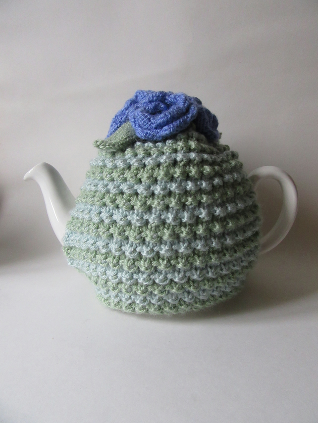 Hand knitted stripy tea cosie with lavender roses