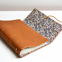 A6 Fold Over Tan Leather handmade notebook floral fabric lining plain paper