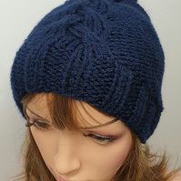 Hand knitted navy blue pompom hat