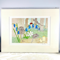 Woodland mouse and bluebells