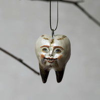 Rancid Colin tooth, a miniature Halloween ceramic hanging decoration