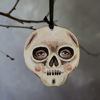 Illustrated skull, wooden hanging decoration